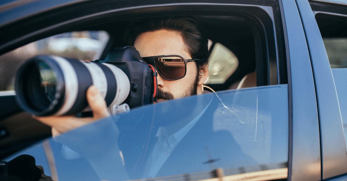 investigator using expensive camera