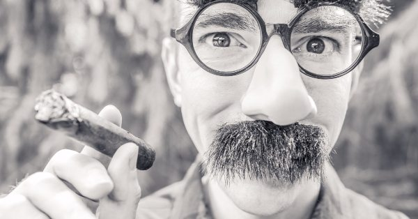 smoking man with moustache