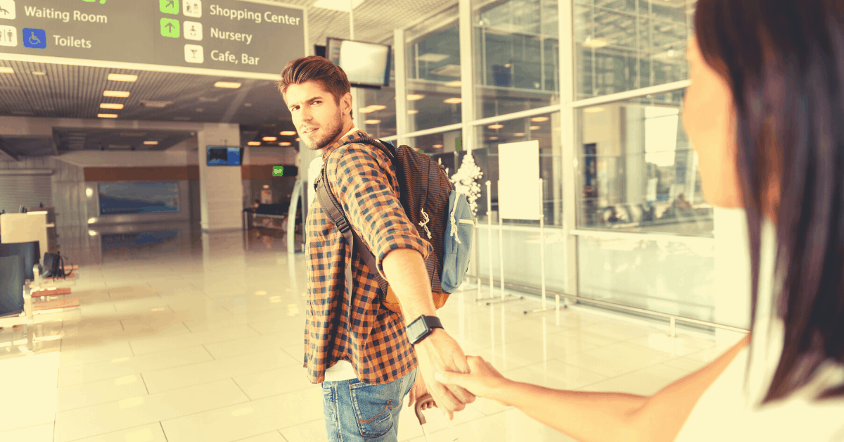 Sign of long-distance cheating. Man not happy leaving wife at airport.
