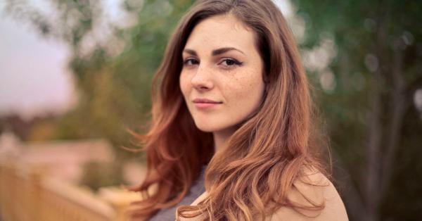 woman half smiling at camera