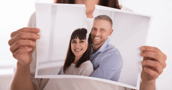 wife tearing marriage picture in half