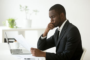 Private investigator reviewing a case
