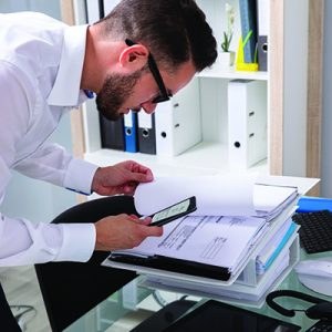 Suspicious individual looking through corporate files