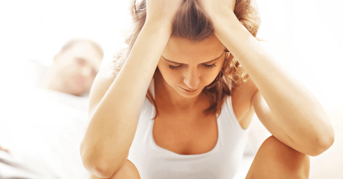 woman with hands in head looking upset